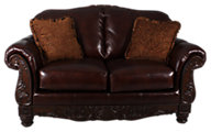 Ashley North Shore 100% Leather Wood Carved Loveseat
