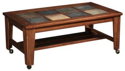 Ashley toscana coffee table with casters homemakers furniture Toscana coffee table