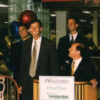 Alan Merschman, Dave Merschman and Roger Merschman celebrate the purchase of Homemakers by Nebraska Furniture Mart.