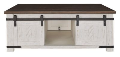 Ashley Wystfield Coffee Table with Sliding Doors