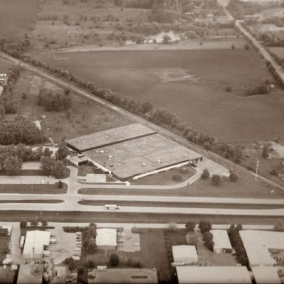 Image shows an aerial view of the Parker Brothers factory circa 1985.