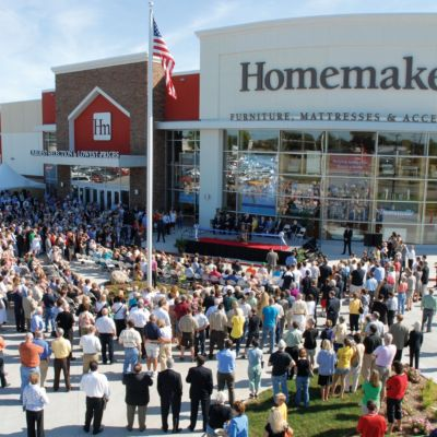 Image shows the 2009 ribbon cutting cereomy for the grand opening of the Urbandale furniture store.
