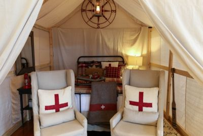 Tent with red and white bedframe